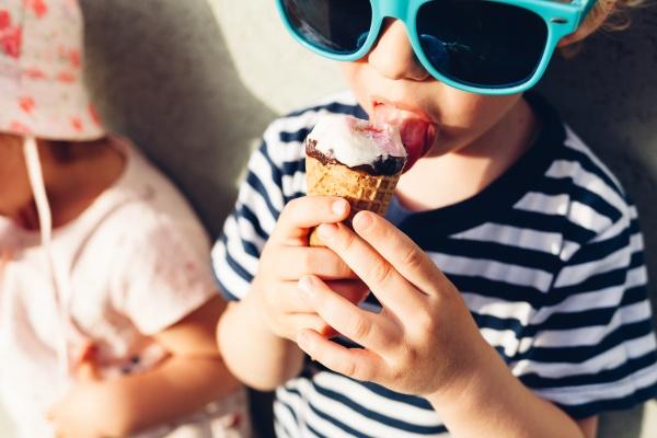 Girl and boy eating ice cream
