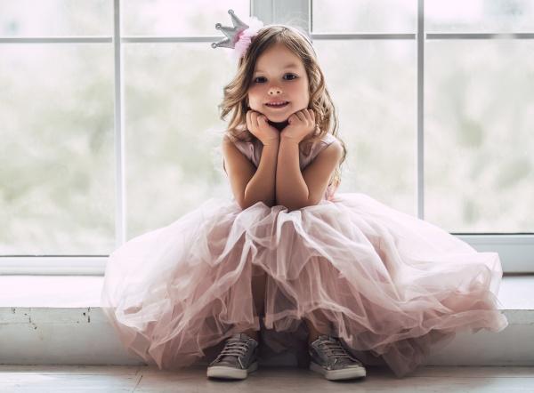 Little cute girl in dress